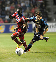Chicago Fire forward Patrick Nyarko (14) battles for the ball with Philadelphia Union midfielder Gabriel Farfan (15).  The Chicago Fire defeated the Philadelphia Union 1-0 at Toyota Park in Bridgeview, IL on March 24, 2012.