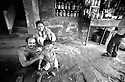 A family in the busy market street of Kolkata