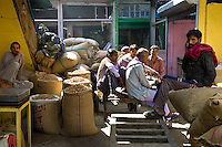 Indian Hindu porters with sacks of spices and dried foods at Khari Baoli Spice and Dried Foods Market in Old Delhi, India