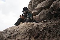 A member of the Free Syrian Army relax reading the Quran, the Islamic Sacred Book. ALESSIO ROMENZI