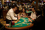 Blackjack table in Las Vegas, Nevada, Caesars Palace and Casino, gaming, gambling, chips, blackjack, betting croupier, blackjack players, model released, blackjack table, cards, NV, Las Vegas, Photo nv233-17930.Copyright: Lee Foster, www.fostertravel.com, 510-549-2202,lee@fostertravel.com