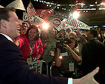 (8-17-00)-LOS ANGELES-METRO--Al Gore walks into the Staples Center prior to giving his acceptance speech in Los Angeles Thursday. Instead of entering from backstage, he entered and shook hands with hundreds of delegates. STAFF PHOTO BY Rodrigo Peña.