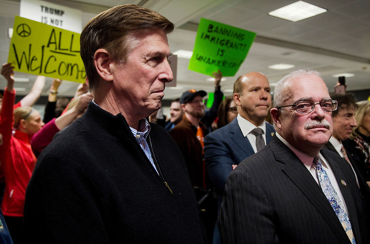 UNITED STATES - JANUARY 29: From left, Rep. Don Beyer, D-Va., Rep. John Delaney, D-Md., Rep. Gerry Connolly, D-Va., and Rep. Jamie Raskin, D-Md., speak to the press and protesters about possible detention of travelers and legal access at Dulles International Airport in Virginia on Sunday, Jan. 29, 2017. Protests erupted at airports around the country following President Trump's executive order restricting travel from several Islamic countries. (Photo By Bill Clark/CQ Roll Call)