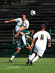 1 September 2009: University of Vermont Catamount midfielder/backfielder Rem Kielman (3), a Junior from Hinesburg, VT, heads the ball over Emery Welshman (10) during action against the Siena College Saints at Centennial Field in Burlington, Vermont. The Saints edged out the Catamounts 1-0. Mandatory Photo Credit: Ed Wolfstein Photo
