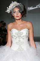 Model walks the runway in a Krystal wedding dress by Katerina Bocci during the Wedding Trendspot Spring 2011 Press Fashion, October 17, 2010.