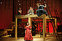 London, UK. 16.09.2015. JANE EYRE, a co-production with the Bristol Old Vic, directed by Sally Cookson, opens at the National Theatre. Picture shows: Melanie Marshall (Bertha Mason - red dress), Madeleine Worrall (Jane Eyre - with mirror) and the company. Photograph © Jane Hobson.