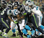 Seattle Seahawks outside linebacker Mike Morgan (57),  cornerback DeShawn Shead (35) and defensive end Cliff Avril (56) wraps up Carolina Panthers running back Jonathan Stewart (28) for a one-yard loss at CenturyLink Field in Seattle, Washington on December 4, 2016.  Seahawks beat the Panthers 40-7.©2016. Jim Bryant photo. All Rights Reserved.