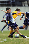 27 November 2005: SMU's Michael Uremovich (20) keeps himself between the ball and UNC-G's Scott Jones (11). Southern Methodist University defeated the University of North Carolina at Greensboro 3-1 at UNC-G Soccer Stadium in Greensboro, North Carolina in a 2005 NCAA Men's Soccer Tournament game.