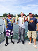 COURTESY PHOTO<br /> YOUTH BASS CHAMPS<br /> Baron Meek (left) and Peyton Wright, both of Siloam Springs, won the 2015 Northwest Arkansas Youth Bass Classic held Sept. 19 at Lake Elmdale. Brian Copeland (right) was their boat captain. Meek and Wright had over 10 pounds, and also won Anglers of the Year. Meek won the prize for big bass.