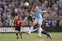 Teal Bunbury (9) forward Sporting KC wins the aerial battle with Andy Rose (25) midfield Seattle Sounders.Sporting Kansas City defeated Seattle Sounders on penalty kicks, after a 1-1 tied game to win the Lamar Hunt Open Cup at LIVESTRONG Sporting Park, Kansas City, Kansas..