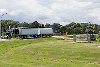 A grain semi-truck leaves the New Rosedale Hutterites colony is seen in Manitoba, Monday August 17, 2015. Hutterites are am ethno-religious group who, like the Amish and Mennonites, trace their roots to the Radical Reformation of the 16th century.
