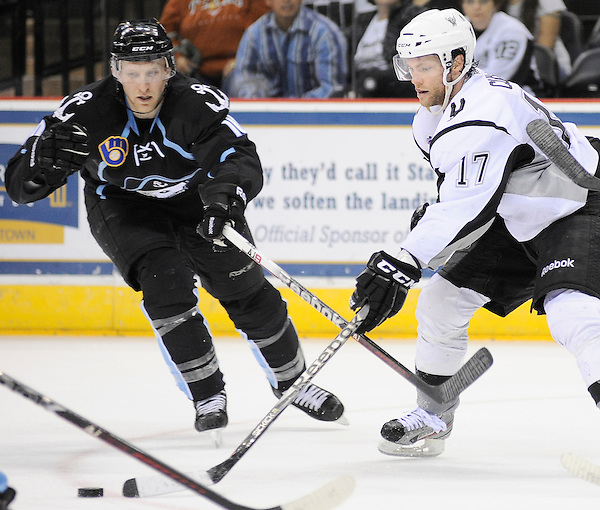 San Antonio Rampage's Mark Cullen, right, chases the puck ahead of Milwaukee Admirals' Ryan Flynn for the puck during the second period of an AHL hockey game, Tuesday, April 10, 2012, in San Antonio. (Darren Abate/pressphotointl.com)