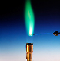 COPPER FLAME TEST: GREEN FLAME.<br /> Cupric Sulfate On Nichrome Wire<br /> (Transition metal) Cupric sulfate compound is dissociated by flame into gaseous atoms, not ions. Atoms of the element are raised to excited state by high temperature of flame. Excess energy from the atom is emitted as light of a characteristic wavelength.