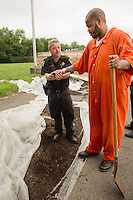 E'Ton Littlepage and Officer Richard Orange check out the finished filtered compost outside the old Holmesburg Prison.