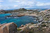 Bay and distant view of the cemetery for the victims of the S&Egrave;millante shipwreck in 1855<br /> France: Corsica, Lavezzi Islands,