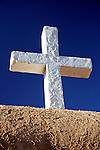 USA, New Mexico, Taos. A wooden cross of the San Francisco de Asis adobe church, a National Historic landmark in Taos, New Mexico.