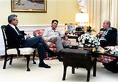 United States President Ronald Reagan, center, meets with National Security Advisor Frank Carlucci, left, and U.S. Secretary of State George Shultz, right, in the White House Residence in Washington, D.C. on Sunday, October 25, 1987.&nbsp; The two men reported to the President on their recent meetings in Moscow..Mandatory Credit: Mary Anne Fackelman-Miner - White House via CNP
