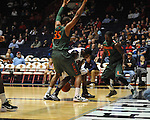 "Ole Miss' Murphy Holloway (31) has the ball knocked away by Miami's Malcolm Grant (3) at the C.M. ""Tad"" Smith Coliseum in Oxford, Miss. on Friday, November 25, 2011. Ole Miss won 64-61 in overtime."