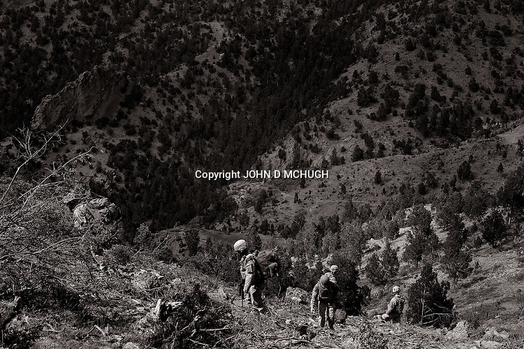 US soldiers from 1/503rd, 173rd Brigade, climb a mountain at Speray Combat Outpost in Khowst province, Afghanistan, 2 May 2008. They were climbing to an observation post that sits in the mountains over looking Speray combat outpost on one side, and the Pakistan border on the other side. (John D McHugh)