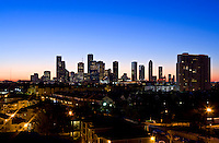 Stock photo of the Houston skyline at dusk from the west.