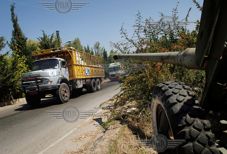 United Nations World Food Progamme (UN WFP) trucks carry UNHCR aid supplies to Tyre during 34 days of conflict between Israel and Hezbollah (Hizbollah).