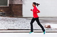 With snow coming down, a runner donned her running shoes and logged an exhilarating mile and a half.