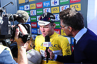 Picture by Simon Wilkinson/SWpix.com - 02/07/16 - Cycling - 2016 Tour de France - Stage 1, Mont-Saint-Michel - Utah Beach - Team Dimension Data's Mark Cavendish is interviewed by TV with his son Frey and daughter Delilah after winning Stage 1 in Utah Beach.