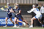 DURHAM, NC - FEBRUARY 26: Notre Dame's Molly Cobb (22) and Duke's Maddie Crutchfield. The Duke University Blue Devils hosted the University of Notre Dame Fighting Irish on February, 26, 2017, at Koskinen Stadium in Durham, NC in a Division I College Women's Lacrosse match. Notre Dame won the game 12-11.