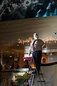 Auctioneer in the main lobby of Galaxy Cinema, Cary, Sat., Jan. 12, 2013. The Triangle's largest art-house cinema closed its doors on Nov. 11, 2012, after eight years of screening Bollywood,  independent and mainstream movies.
