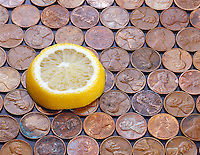 LEMON REMOVES COPPER TARNISH (1 of 2)<br /> Citric Acid and Copper Oxide<br /> A slice of lemon is placed on a bed of tarnished copper pennies.