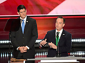 Reince Priebus, RNC Chairman, right, explains the rule after the Alaska Delegation was polled as Speaker of the United States House of Representatives Paul Ryan (Republican of Wisconsin), left, looks on at the 2016 Republican National Convention held at the Quicken Loans Arena in Cleveland, Ohio on Tuesday, July 19, 2016.<br /> Credit: Ron Sachs / CNP<br /> (RESTRICTION: NO New York or New Jersey Newspapers or newspapers within a 75 mile radius of New York City)