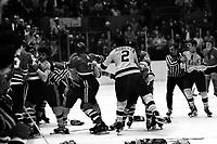 California Golden Seals vs Chicago Black Hawks fight.<br />Hawks Keith Magnuson #3 Dennis Hextal #22<br />(1970 photo/Ron Riesterer)
