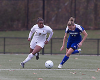 Boston College forward Natalie Crutchfield (9) accelerates with the ball as Hofstra University defender Dana Bergstrom (11) closes. Boston College defeated Hofstra University, 3-1, in second round NCAA tournament match at Newton Soccer Field, Newton, MA.