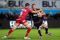 Schalk Burger of Saracens is tackled by David Bulbring of the Scarlets. European Rugby Champions Cup match, between Saracens and the Scarlets on October 22, 2016 at Allianz Park in London, England. Photo by: Patrick Khachfe / JMP