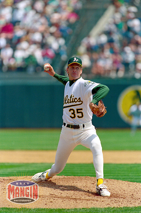 OAKLAND, CA - Bob Welch of the Oakland Athletics pitches during a game at the Oakland Coliseum in Oakland, California in 1991. Photo by Brad Mangin