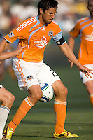 Houston Dynamo forward Brian Ching (25) traps ball between his knees. The LA Galaxy defeated the Houston Dynamo 4-1 at Home Depot Center stadium in Carson, California on Saturday evening June 5, 2010..