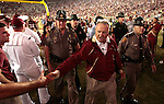 Florida State head coach Bobby Bowden shakes a fan's hand as he leaves the field after the University of Miami's 38-34 defeat of the Florida State Seminoles in Tallahassee September 7, 2009. (Mark Wallheiser/TallahasseeStock.com)