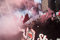 Antifascists march through the East End of London to mark the 80th anniversary of the battle of Cable street. 9-10-16