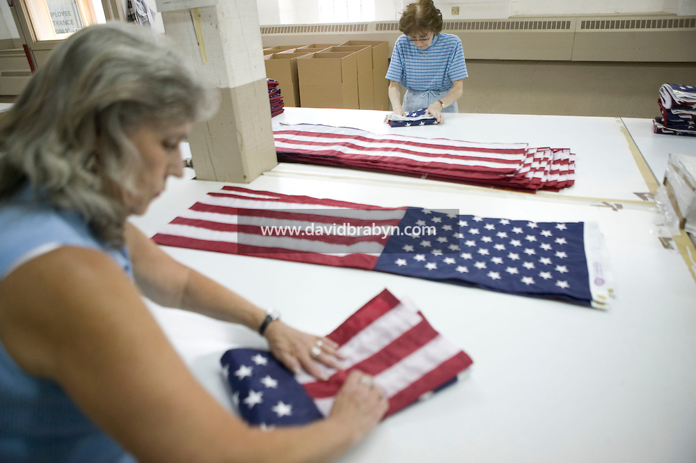 1 June 2005 - Oaks, PA - Workers fold American flags at the Annin & Co. flag manufacturing plant in Oaks, PA. Photo Credit: David Brabyn