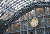 Train shed and station clock in St. Pancras station, London, England