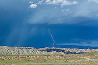 Lightning strike in the badlands of the Bighorn Basin of Wyoming