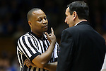 16 January 2016: Referee Michael Stephens (left) talks with Duke head coach Mike Krzyzewski. The Duke University Blue Devils hosted the University of Notre Dame Fighting Irish at Cameron Indoor Stadium in Durham, North Carolina in a 2015-16 NCAA Division I Men's Basketball game. Notre Dame won the game 95-91.