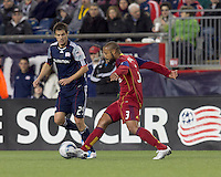 Real Salt Lake defender Robbie Russell (3) dribbles as New England Revolution midfielder Marko Perovic (29) defends. In a Major League Soccer (MLS) match, Real Salt Lake defeated the New England Revolution, 2-0, at Gillette Stadium on April 9, 2011.