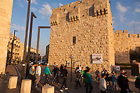 Pedestrians at the Jaffa Gate of the Old City of Jerusalem.