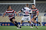 Sherwin Stowers makes a run at Gareth Anscombe. ITM Cup Round 7 rugby game between Auckland and Counties Manukau, played at Eden Park, Auckland on Thursday August 11th..Auckland won 25 - 22.
