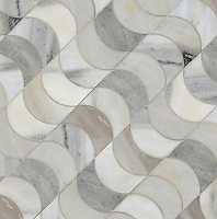 Demi Lune, a waterjet stone mosaic, shown in water jet cut honed Angora, is part of the Illusions™ Collection by Sara Baldwin for New Ravenna.