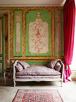 Gerard Tremolet painted the monkey motif on the wall panels of one of the salons which is furnished with a Louis XV daybed