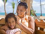 Mother and daughter hug near a beach in Samana Penninsula, Las Terranas, Dominican Republican