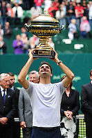 Roger Federer holding the trophy after winning the Gerry Weber Open 2013 at Gerry Weber Stadium in Halle (Westfalia), Germany on June 16, 2013. Photo: Miroslav Dakov