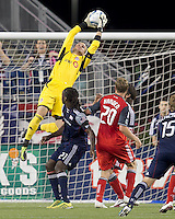 Toronto FC goalkeeper Stefan Frei (24) gets high to capture a corner kick. In a Major League Soccer (MLS) match, the New England Revolution tied Toronto FC, 0-0, at Gillette Stadium on June 15, 2011.